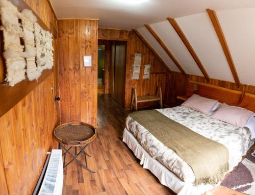 A bed or beds in a room at Hostal Muller