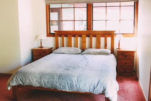 A bed or beds in a room at Tranquil Point