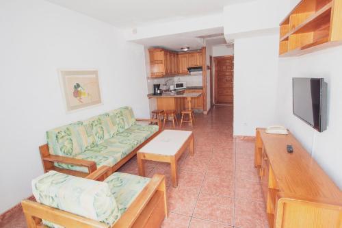 Posezení v ubytování Montecarlo Apartamento40
