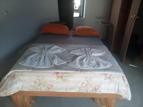 Un ou plusieurs lits dans un hébergement de l'établissement Pensao Casa José Doce
