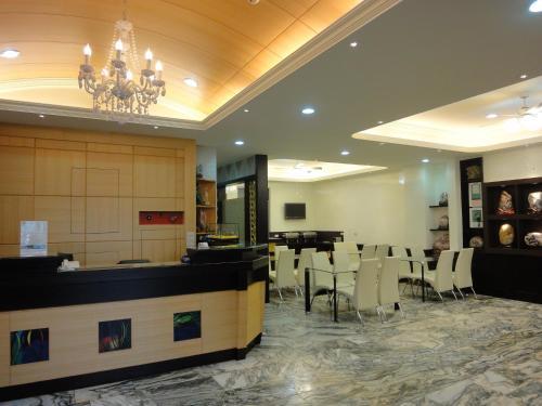 陶陶居商旅 Tautauchu Hotelにあるレストランまたは飲食店