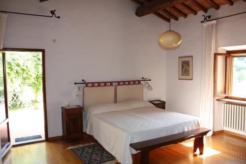 A bed or beds in a room at B&B Il Torrino di Sotto
