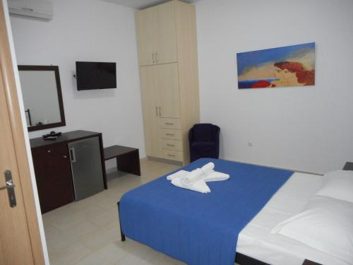 A bed or beds in a room at Anatoli