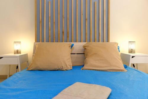 Un ou plusieurs lits dans un hébergement de l'établissement Le joyau de la Joliette