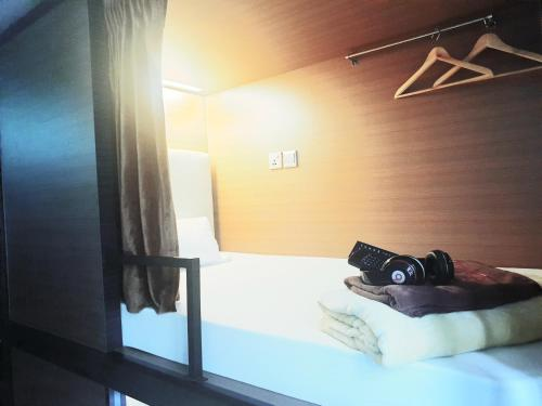 A bed or beds in a room at Chic Capsule Otel