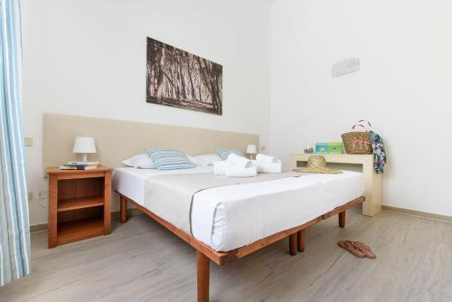 A bed or beds in a room at Villaggio Orizzonte