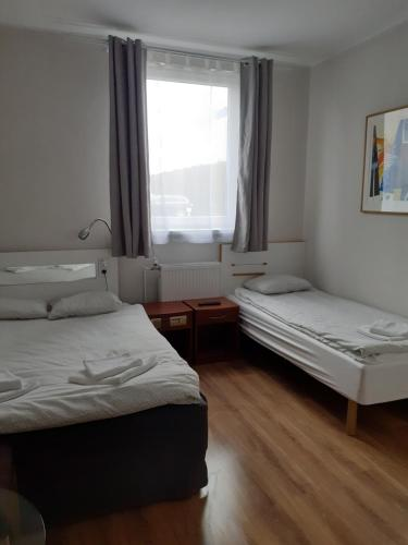 A bed or beds in a room at Pokoje Gościnne