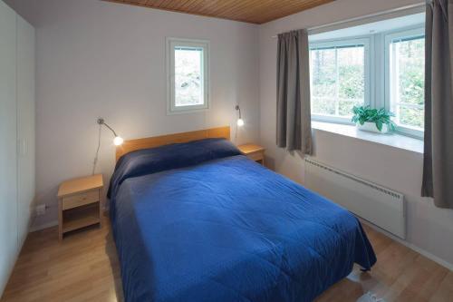 Säng eller sängar i ett rum på Holiday Club Punkaharju Cottages