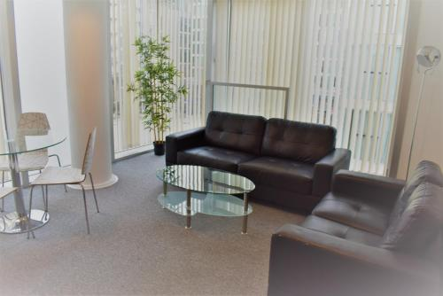 A seating area at Bourdeaux Hub Apartments