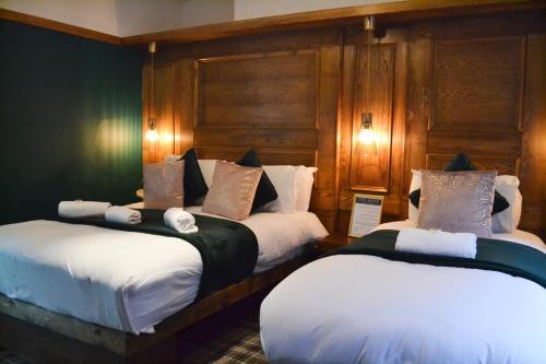 A bed or beds in a room at The Mitre Hotel