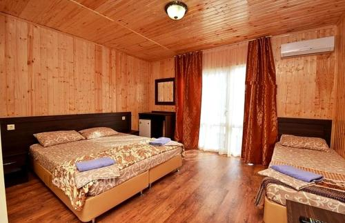 A bed or beds in a room at Svetliy Guest House