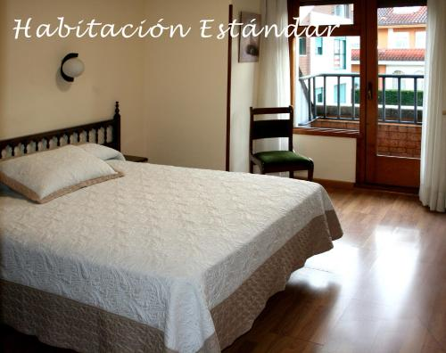 A bed or beds in a room at Hotel Cangas de Onis Center