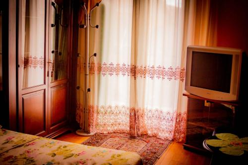 TV o dispositivi per l'intrattenimento presso Bed And breakfast Kalinka