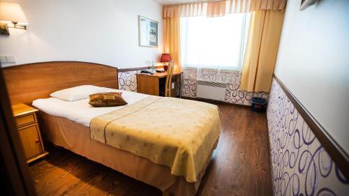 Voodi või voodid majutusasutuse Hestia Hotel Susi toas