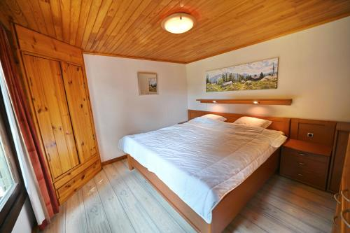 A bed or beds in a room at Bironix