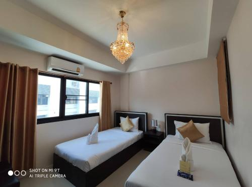 A bed or beds in a room at Bann Tawan Hostel & Spa