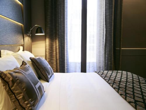A bed or beds in a room at The Style