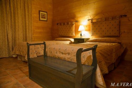 A bed or beds in a room at Aras Rural