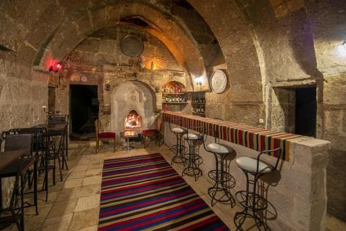 مطعم أو مكان آخر لتناول الطعام في Cappadocia Antique Gelveri Cave Hotel