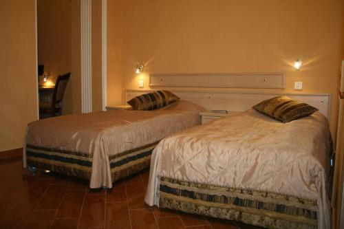 A bed or beds in a room at Boutique Hotel Pavo