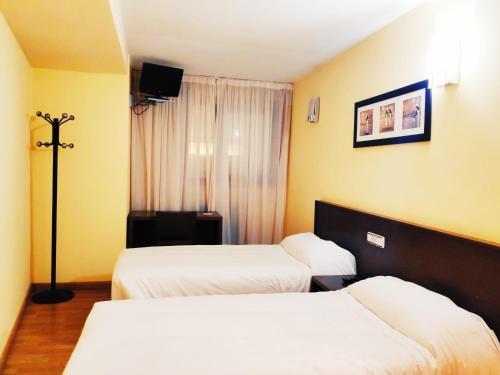 Cama o camas de una habitación en Hotel Santa Catalina by Bossh Hotels