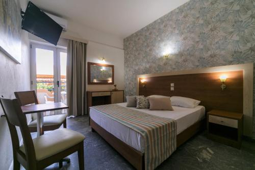 A bed or beds in a room at Erato Hotel