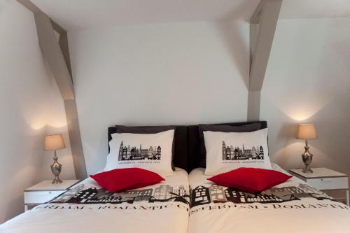A bed or beds in a room at Top Of The City