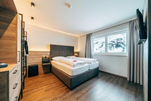 A bed or beds in a room at FOXY Obertauern