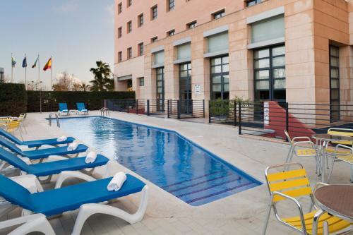 The swimming pool at or near Holiday Inn Express Ciudad de las Ciencias, an IHG Hotel