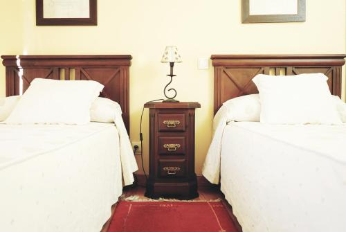 A bed or beds in a room at DC Mesones 21