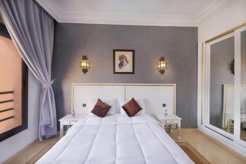 Un ou plusieurs lits dans un hébergement de l'établissement Mogador Menzah Appart Hôtel
