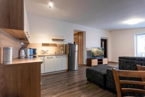 Kuchyňa alebo kuchynka v ubytovaní Mami Style Apartments