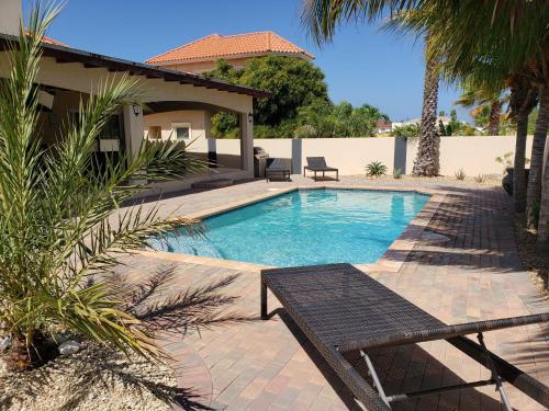 The swimming pool at or near Opal Villa
