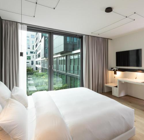 A bed or beds in a room at KPM Hotel & Residences