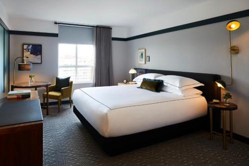 A bed or beds in a room at Kimpton Saint George Hotel, an IHG hotel