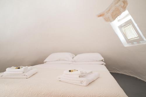 Een bed of bedden in een kamer bij Trullidea