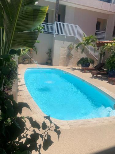 The swimming pool at or near Pousada e Restaurante Manah