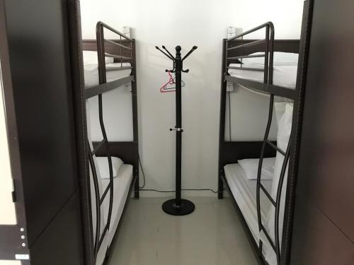 A bunk bed or bunk beds in a room at Island Hostel