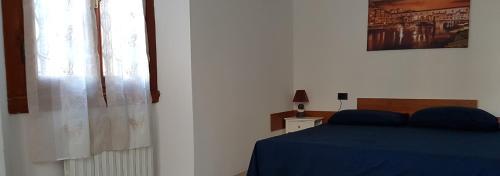 Letto o letti in una camera di La mia Firenze
