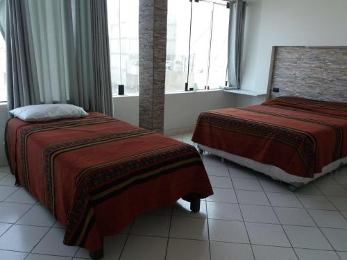 A bed or beds in a room at Hostal Fatima