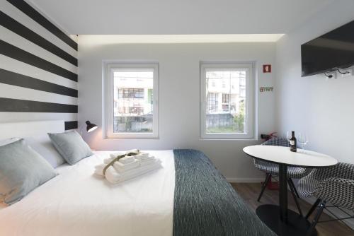 A bed or beds in a room at Apartamentos do Prado In Douro