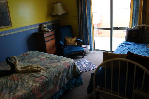 A bed or beds in a room at Atlantis Backpackers