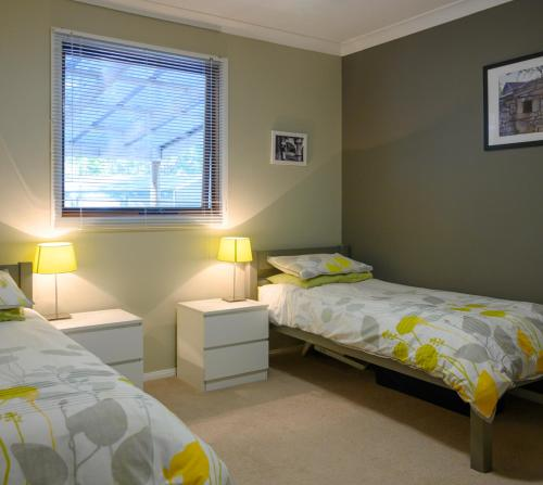 A bed or beds in a room at Friends at McLaren Vale