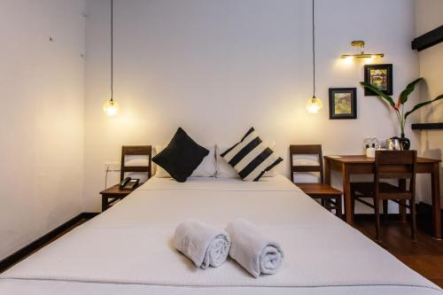 A bed or beds in a room at The Marian Boutique Lodging House