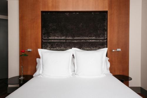 Un ou plusieurs lits dans un hébergement de l'établissement Hotel Banke Opera, Autograph Collection