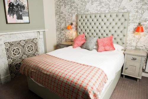 A bed or beds in a room at Crown Hotel Wetheral