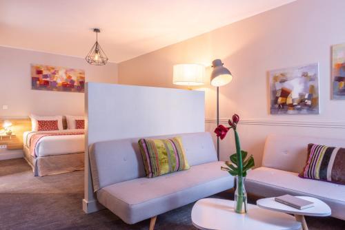 Uma área de estar em Hotel 29 Lepic