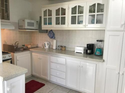 A kitchen or kitchenette at Clarice Apartments
