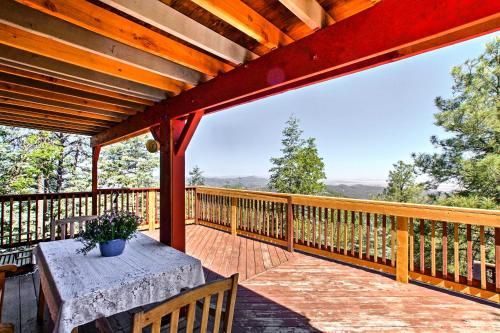 A balcony or terrace at Spacious Cabin with Deck, Mtn Views, Fire Pit and Grill