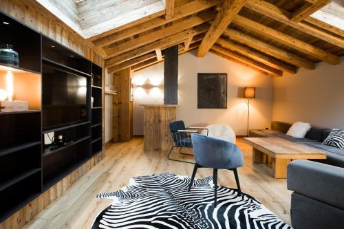 A television and/or entertainment center at Le Chalet Nativ